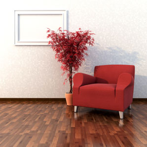 Aardvark Dustless Floor Sanding Services in Norwich and Norfolk > image of polished wooden floor with red chair and plant